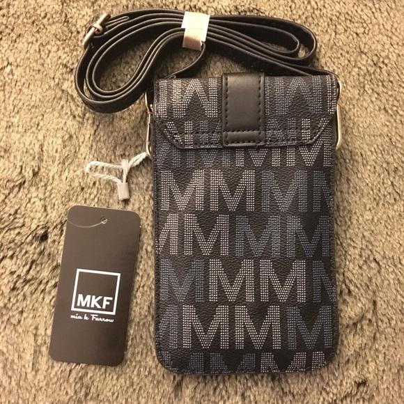 9dba33f01 ... Lulu M Signature Phone Wallet. NWT. Mia K Farrow.  M_5c472373fe51513180a937aa. M_5c472377951996afd9d1c22c.  M_5c4723793c9844ed9006c5a9